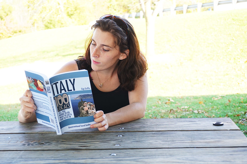 Gigi with her travel guide