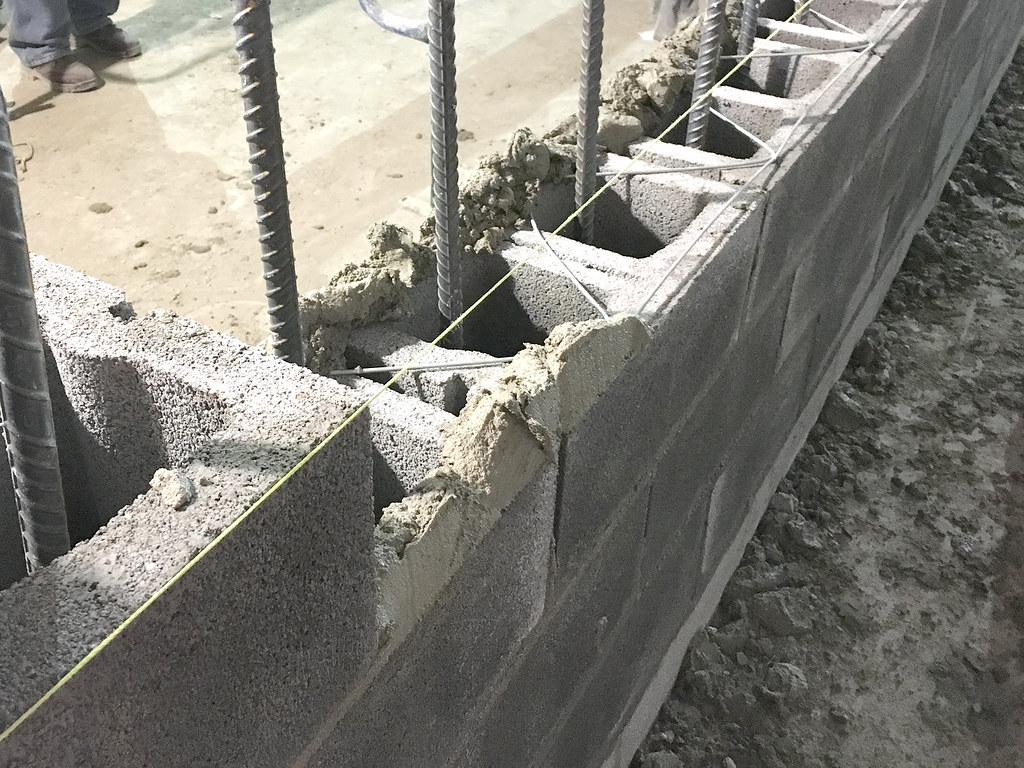 installation and reinforcement of a new cmu block wall in flickr