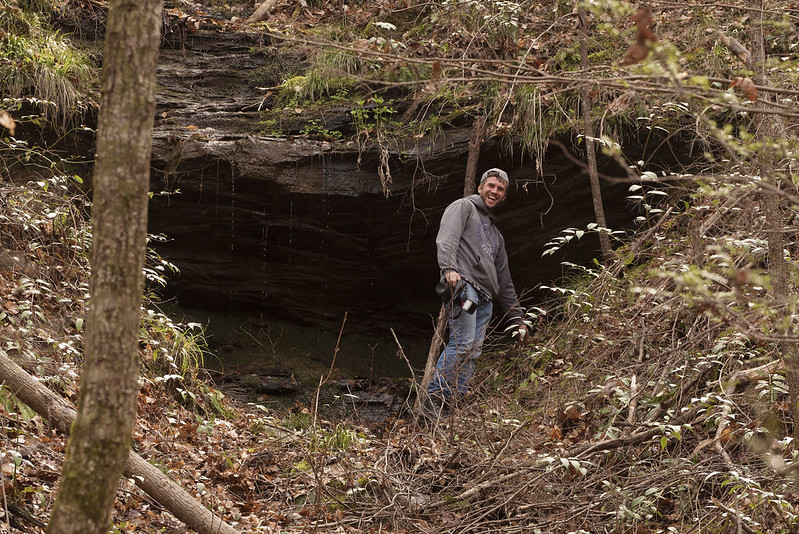 Alex Patton in front of a cave while looking for Salamanders