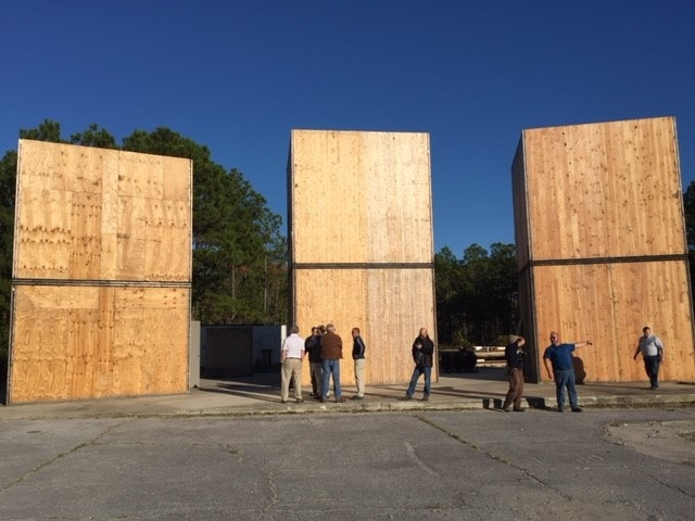 Forest Service scientists, staff, and partners preparing to test the integrity of CLT structures