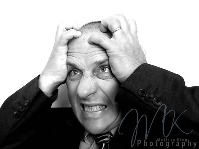 Businessman with hands on head | by Melissa King - melissaking.ca