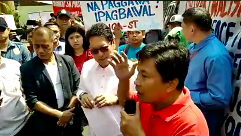 KMU General Secretary Jerome addresses workers in a rally targeting the Labor Secretary on the issue of contractualization in the Philippines.