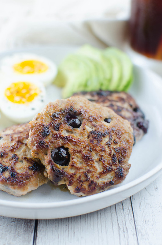 Paleo Maple Blueberry Turkey Breakfast Sausage - the perfect paleo breakfast! Lean ground turkey is mixed with spices, fresh blueberries, and maple syrup. You won't believe how easy homemade breakfast sausage is!