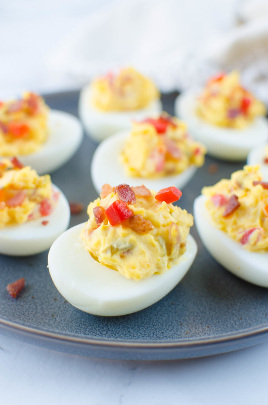Bacon Pimento Cheese Deviled Eggs - a twist on the classic! Deviled egg filling is mixed with crispy bacon, cheddar cheese, and pimentos. So delicious and the perfect way to use all those Easter eggs!