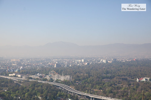 View of west Mexico City from the rooftop of Hyatt Regency (at the helipad) with a hazy view of the Sierra Madre mountains | by thewanderingeater