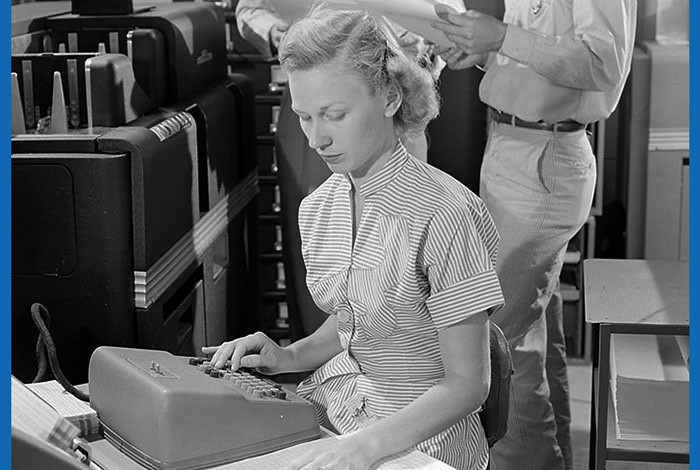 A Los Alamos scientist using a Marchant calculator in July 1951