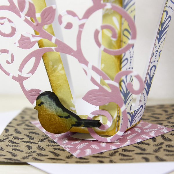 Pretty spring crafts - lantern table decoration - wooden bird closeup