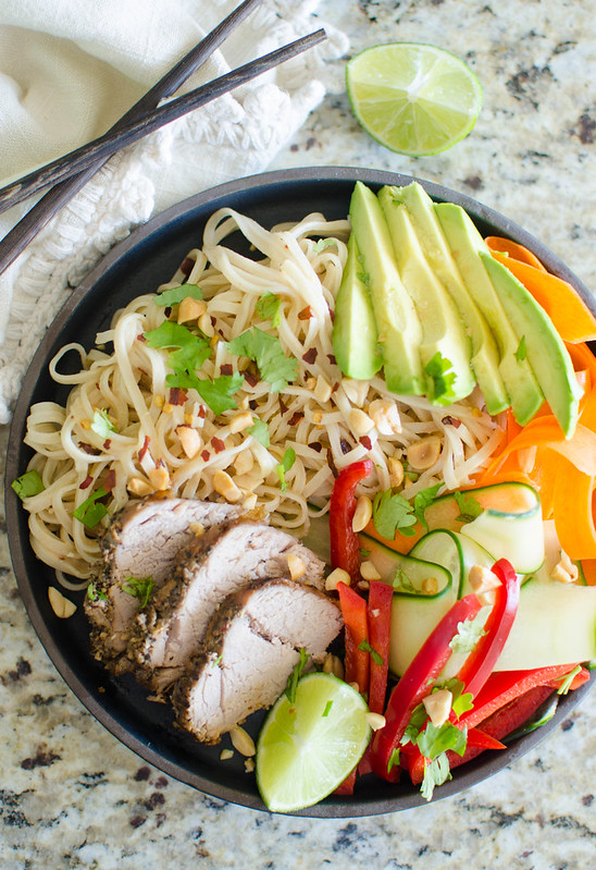Pork Spring Roll Bowl - everything you love about spring rolls in a bowl! Rice noodles in a spicy peanut sauce, with thinly sliced pork, cucumber, carrots, avocado, fresh herbs, and chopped peanuts on top!