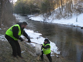 Photo of Maryland Department of Natural Resources staff stocking streams with trout in winter.
