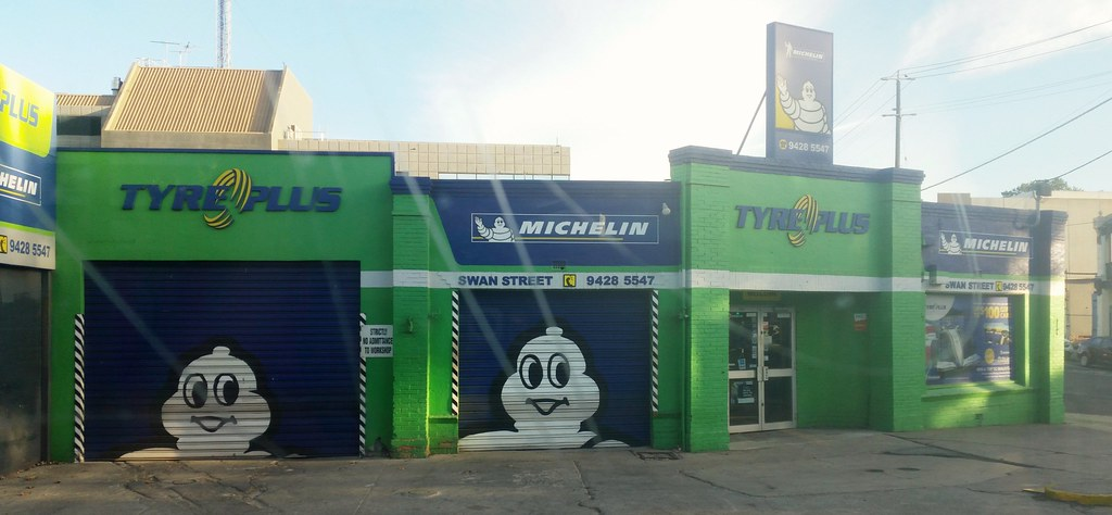 ... A Michelin tyre centre painted green and blue with the white head of the   & A Michelin tyre centre painted green and blue with the whu2026 | Flickr
