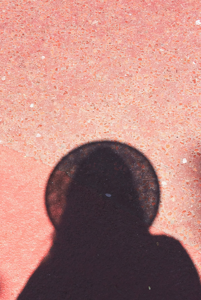 shadow portrait with straw hat