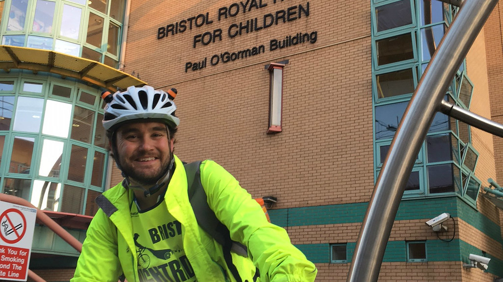 Andy outside the Bristol Royal Hospital for Children on stage one of his triathlon - the Bristol 100k Nightrider.