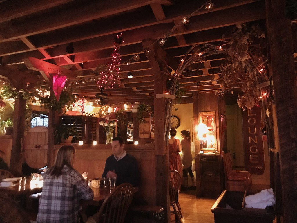 restaurant interior with twinkle lights and flower, leaf decorations