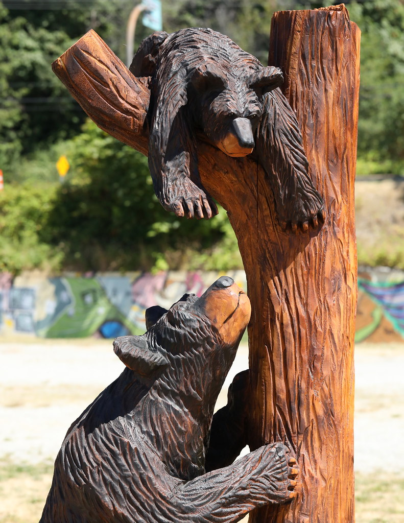 Chainsaw carving bear family detail paul den ouden flickr