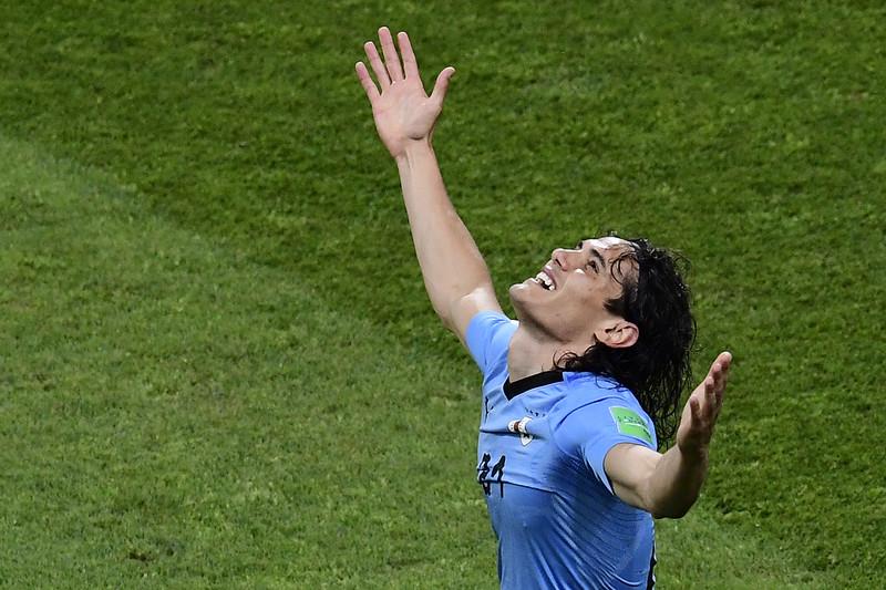Edinson Cavani攻進致勝球後慶祝。(AFP授權)