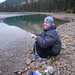 Colette pumping filtered water, Yoho Lake, BC, Canada