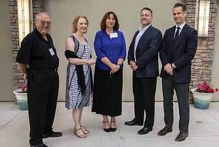 Standing from left to right are Antonio Redondo, Nancy Jo Nicholas, Bette Korber, Lee Finewood and Daniel Lockney