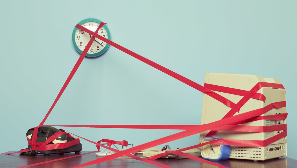 Office desk covered in red tape