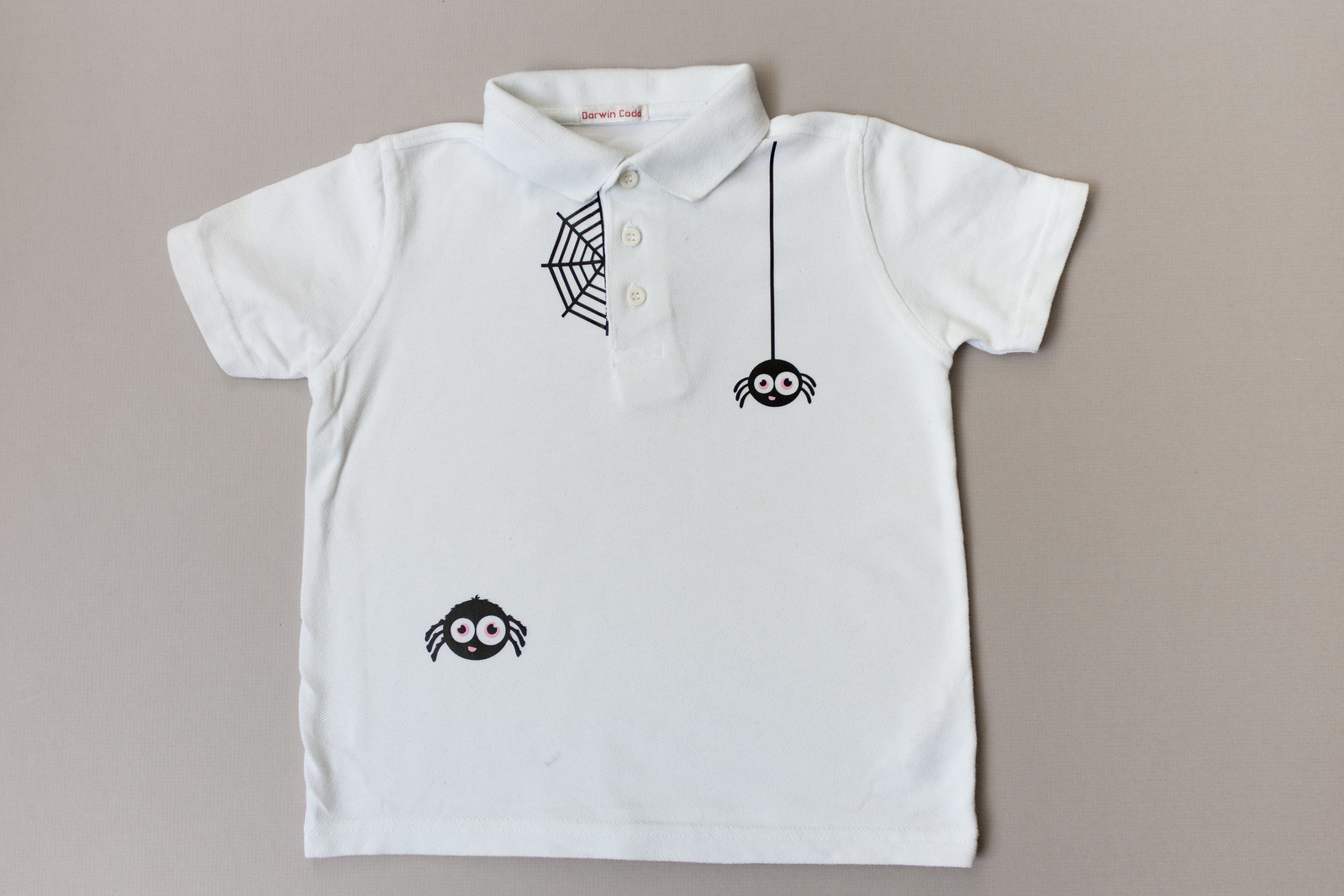 polo shirt with spider and web decoration