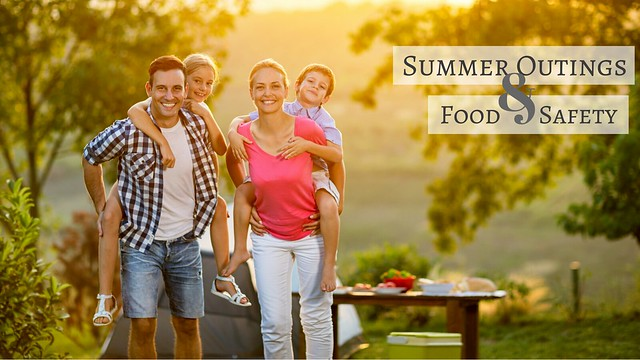 Family camping in park. Summer outings & food safety