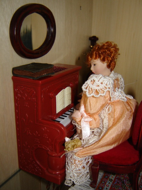 Molly playing the piano.