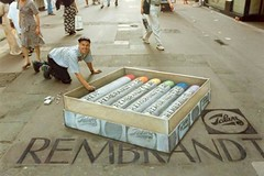 "Example Of 3D Sidewalk Art: The Artist Reaches For His ""Box Of Chalks""! 