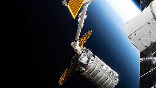 The Cygnus space freighter is poised for release from the Canadarm2 | by NASA Johnson