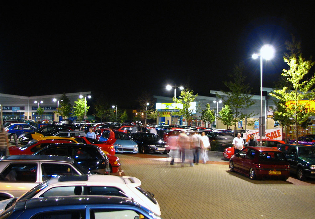 People meeting to show off their cars in a car park