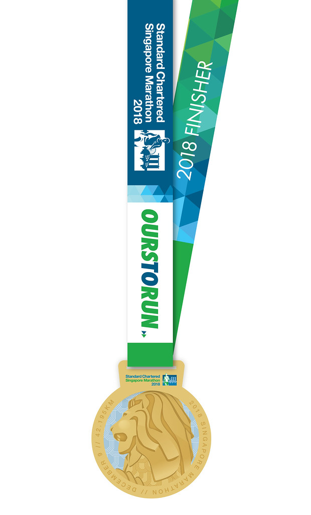 The 2018 medal features a gold-plated Merlion. Credit: Standard Chartered Singapore Marathon