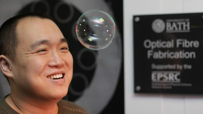 Fei Yu and long and thin bubbles of glass in the fiber