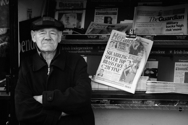 Old Man At Newspaper Stand
