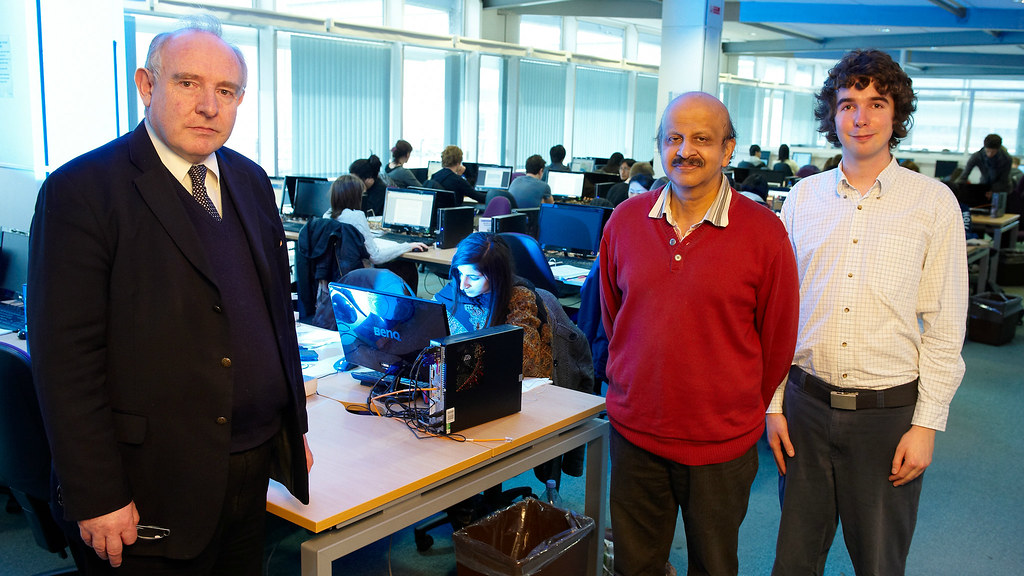 Dr Redfern (left), Professor Raj Aggarwal and Benjamin Williamson (right) among the machines in the University's library