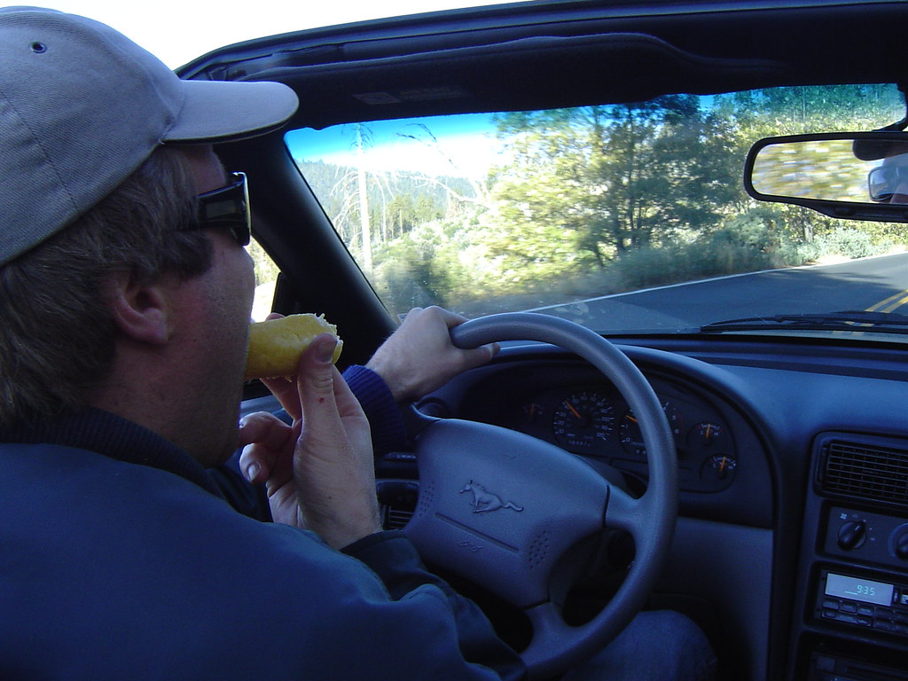 Man driving and eating