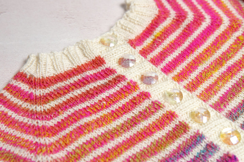 close of up rainbow hand knitted toddler cardigan