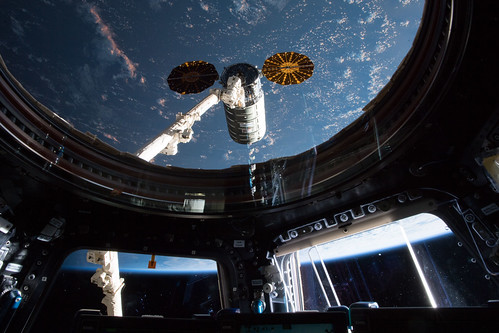 The Orbital ATK space freighter moments before it was grappled with the Canadarm2 robotic arm | by NASA Johnson