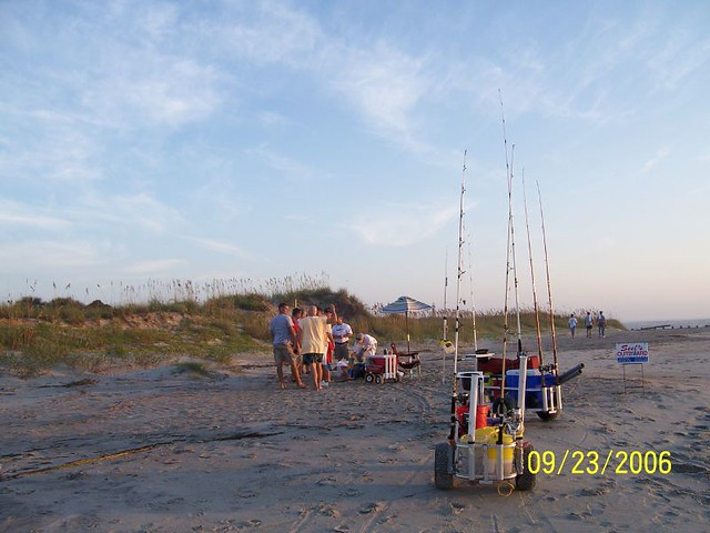 More morning carts loaded with gear and refreshments of co for South carolina surf fishing