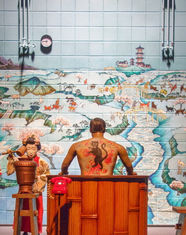 isle of dogs exhibition - mayor kobayashi in the bath house
