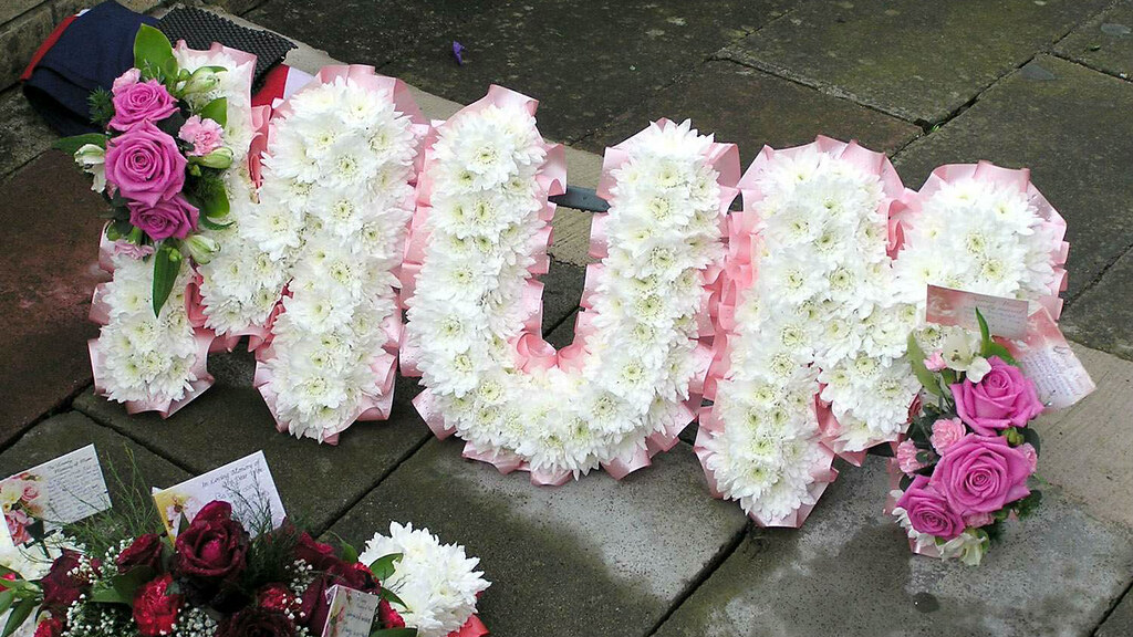 Funeral floral tribute at Haycombe Cemetery in Bath