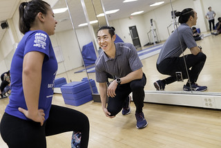 Paul Choi works with students in his kinesiology fitness class held in Pearson Hall. | by Temple CPH