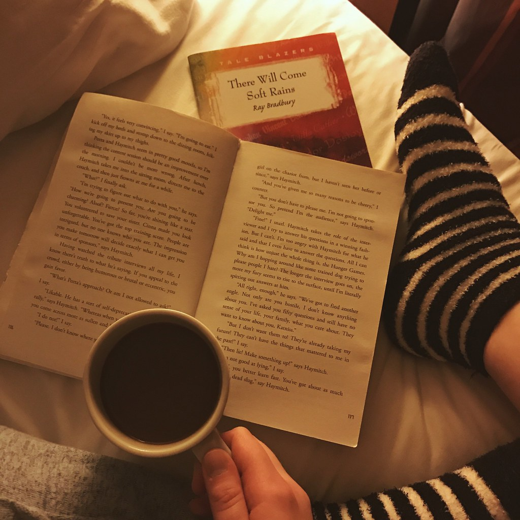 reading in bed with hot cocoa
