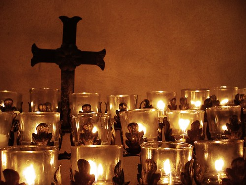 Cross and votives | by selva