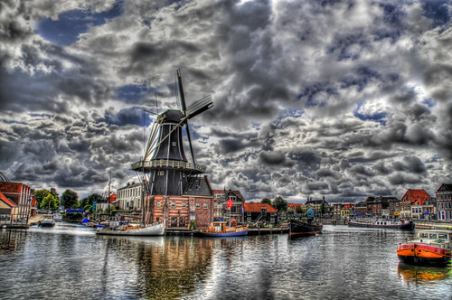 Windmill on a Cloudy Canal | by Stuck in Customs