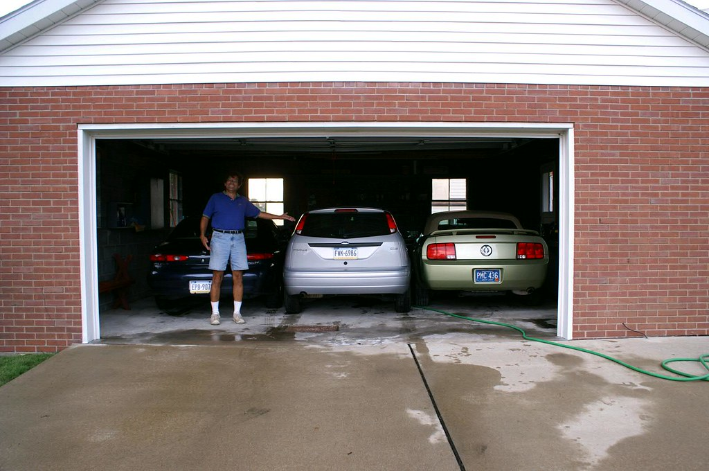 2.5 car garage holding 3 cars | there is about 2 inches betw… | flickr