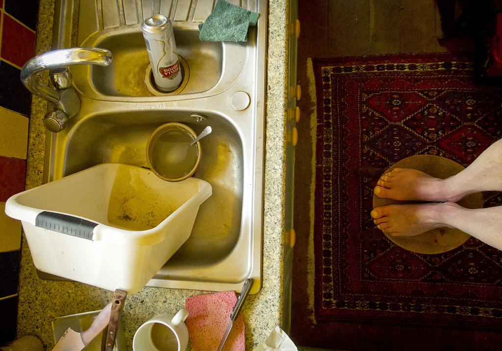 Dirty kitchen sink and feet | Paul Weston | Flickr