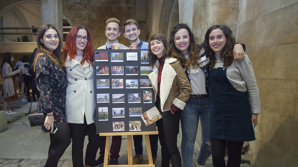 First prize winner of the 'Cultural Heritage' photo competition with friends and her entry