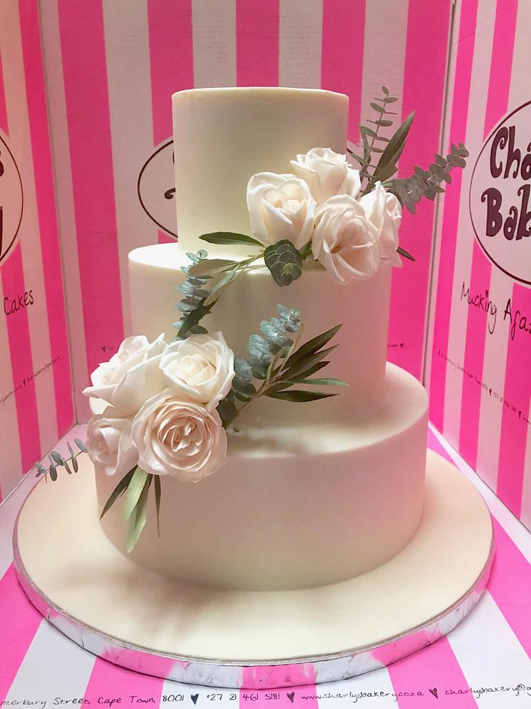 3-tier wedding cake iced white ganache with 2 arrangements… | Flickr
