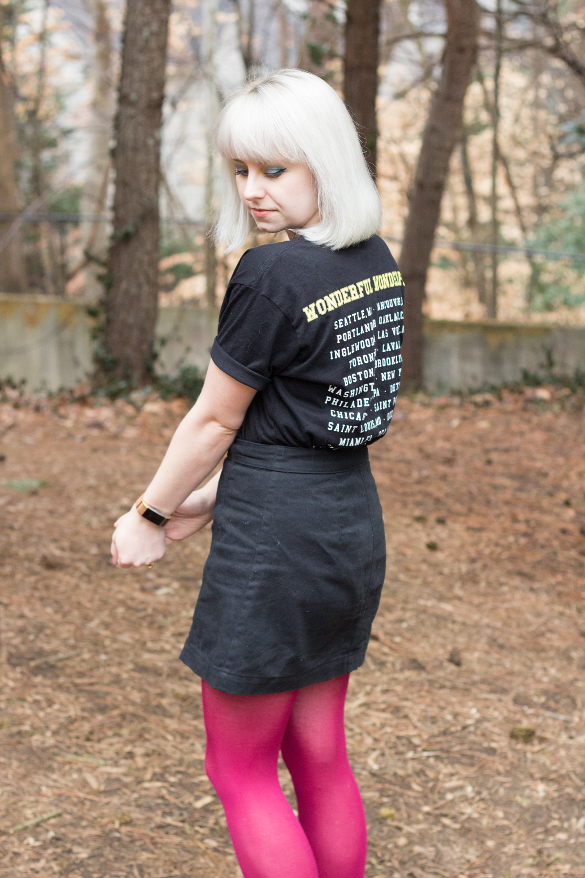The Killers Concert Tee with a Black Denim Mini Skirt and Pink Tights