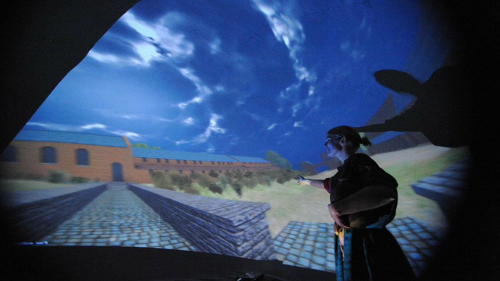 Visitors inside the dome experience a planetarium style show about the villa