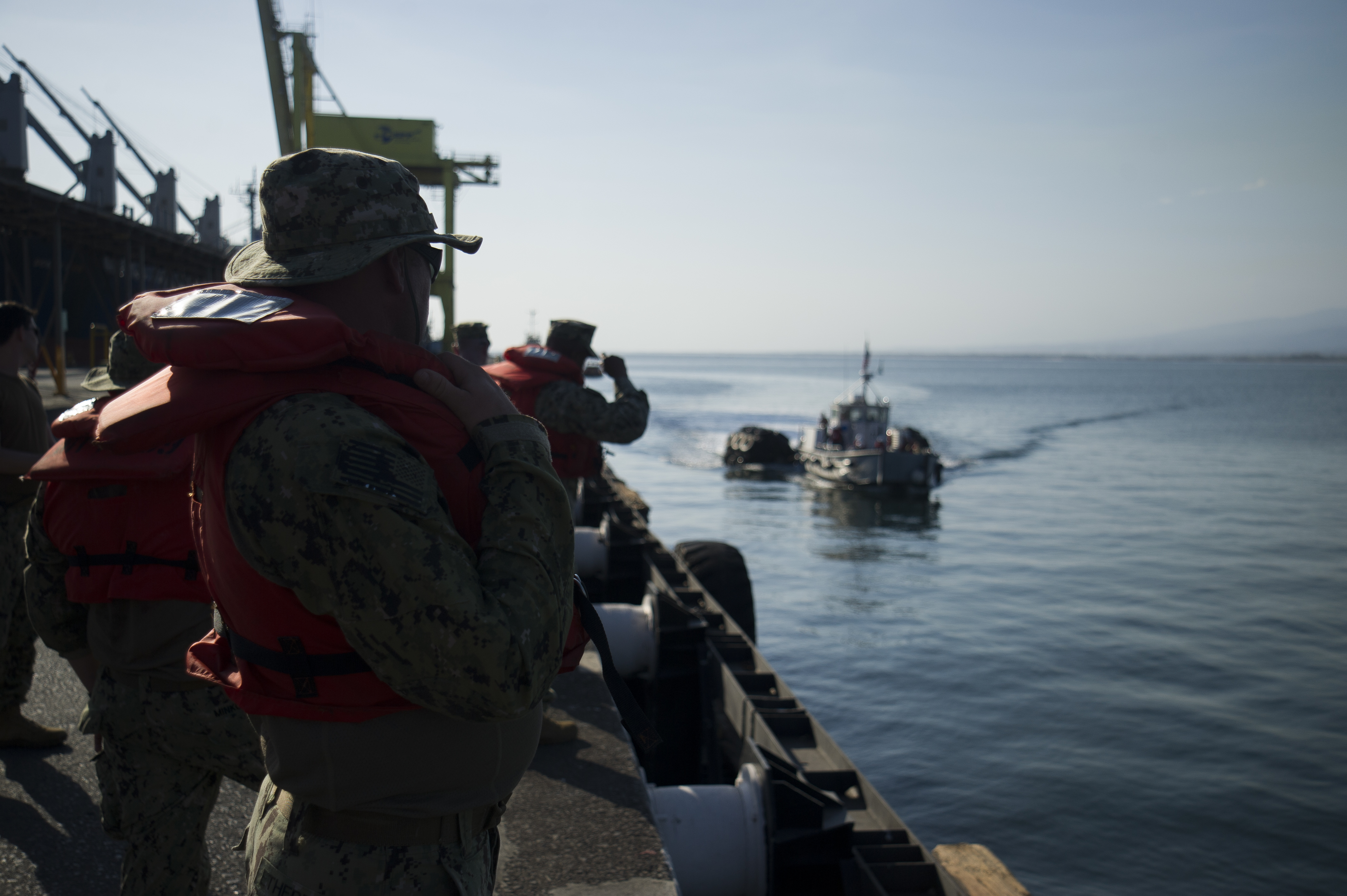 ACAJUTLA, El Salvador — Naval Beach Group (NBG) 2 kicked off Joint Logistics Over the Shore (JLOTS) 18 exercise with lowering and assembly of Improved Navy Lighterage System Causeway Ferries from USNS Brittin (T-AKR 305) April 18, 2018.