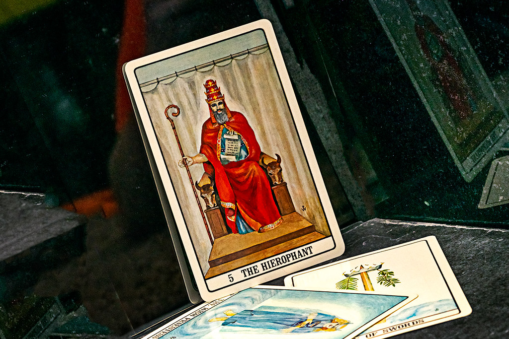Tarot cards: The Hierophant, The High Priestess, the Ace of Swords